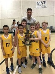 Grade 3 and Coach Guadnola with their trophy