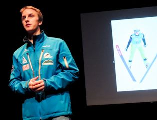 US Olympic Ski Jumper and Proctor Alum Nick Fairall '07 speaks to Proctor students and faculty during assembly.
