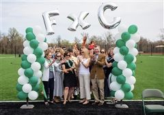 Head of School Cathy McGehee and Board Chair Anne Michele Lyons Kuhns '87, assisted by Board members (front row, left-right) Anne Harrison Armstrong '75, Elizabeth Hazard '82, Hope Jones '82, and David MacDonald (P. '12, '14, '19) cut the ribbon officially dedicating the 145,500 sq. ft. environmentally friendly synthetic turf.