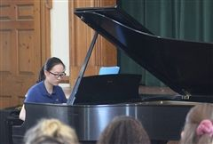 Scarlett D. '21 began last Thursday's recital on the piano with