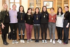 STEM Teacher Meghen Tuttle, juniors Betsy A., Julia C., Moni C-P., Eunice Y., and Scarlett D., and seniors Cassie Z., Joy W., and Shea H. were elected to the Foxcroft School Chapter of the Cum Laude Society. English teacher Anne Burridge (not pictured) was also elected.