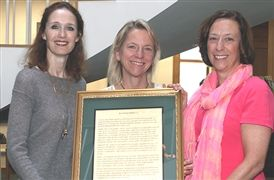 (from right) Head of School Cathy McGehee, Board of Trustees President Reggie Groves '76 and Trustee Trevania Henderson '76 hold the Anne Kane McGuire Award resolution given, posthumously, to Ruth Bedford '32
