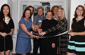 Head of School Cathy McGehee had help from former Head of School Mary Lou Leipheimer, Board Chair Anne Michele Lyons Kuhns '87, trustees Mercedes Rudkin Gotwald '72, Ellen MacNeille Charles '55, and Victoria B. Mars '74, and senior student leaders Chloe X. and Elle L. with the ribbon cutting during Court's rededication.