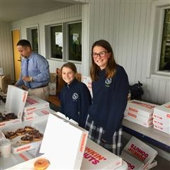 Sarah and Nicole sell donuts for Mbahe.