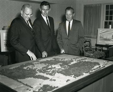 Sandy Mills '34, chairman of Major Gifts Division, Sam Scovil '41, trustee, and Gene Kinder '34, trustee, review the map of the East Campus at the kick-off dinner.
