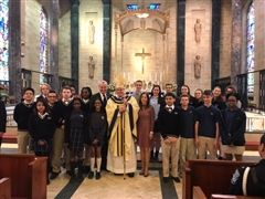 Bishop O'Connell, Governor Murphy and the First Lady took time to take a photo with some students in attendance.