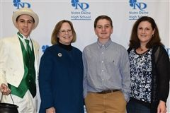 Aidan McGovern, Class of 2023, with his mother, Catherine, Ms. Ivins and the ND Leprechaun