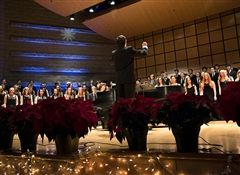 Director of Choral Music Andrew Dibble leads the Concert Choir at the 2017 Holiday Concert. (Photo/Michael Sheehan)