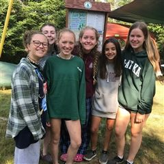 Meg MacLaury '23 (third from left) celebrates her Junior Maine Guide Certification with fellow campers