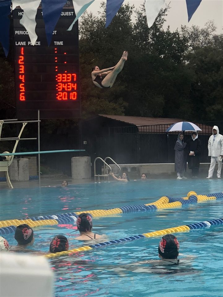 Julia Kasputis '19 wins the diving competition with a career high dual meet score