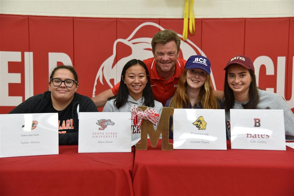 Athletic Director Steve Bergen with four college-bound Cub athletes