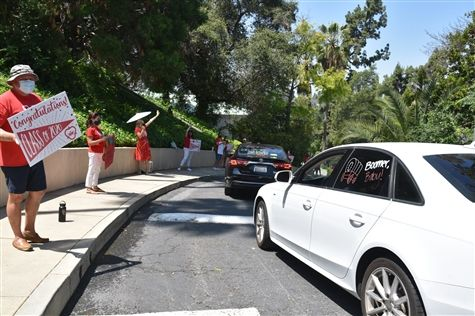 Our annual college car decorating day, which is usually a communal laugh-fest in the Senior parking lot, became a jubilant car parade through campus.