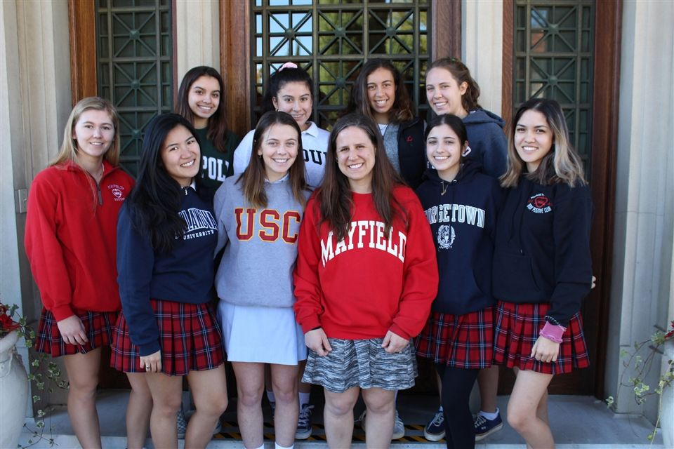 Commencement speaker Dr. Betsy Sinclair '98 (in red Mayfield sweatshirt) with members of the Class of 2019