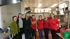 Campus Ministry Council members serve breakfast at Union Station Homeless Services