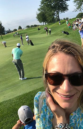 Millman's selfie with Tiger Woods in the background
