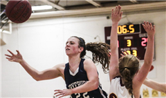 'Fryeburg Academy guard Julia Quinn collides with Cape Elizabeth's Kelly O'Sullivan while attempting to shoot Thursday in a Class A South season finale. Fryeburg won, 40-27.' (Whitney Hayward Photo)