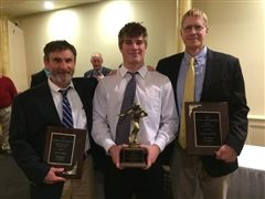 Fryeburg Academy head coach David Turner (right), assistant coach David Jones, and Tucker Buzzell '19 awarded the Campbell Conference Head Coach of the Year, Assistant Coach of the Year, and Player of the Year respectively.