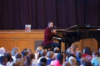 Bryard Huggins '13 shares how he composes music during Assembly..