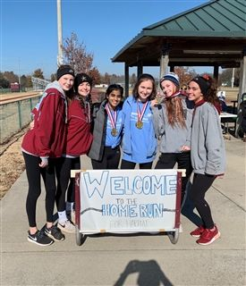 Students in the Habitat for Humanity Club pose at the River Campus during the 5K and 1.5-mile fun run in 2019.