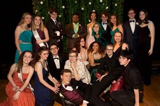The members of Class of 2019 at Prom, an event previously planned and funded by the Junior Auction.