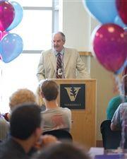 Director Vince Durnan speaks to students during Senior Induction.