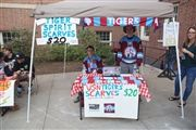 The hockey team sells scarves during Fall Fest.