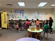 Second graders tour the identity work of kindergartners.