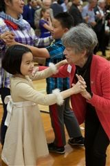 The Class of 2027 dances with grandparents and special friends.