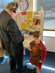 Director Vince Durnan meets Julius Caesar during third grade's living museum in December.
