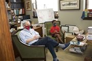 George Bell '30 visits Director Vince Durnan in his office.