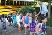Director Vince Durnan greets students who rode the Morning Bus to school in August 2019. The four buses arrive at the Edgehill Campus by 7:30 a.m.