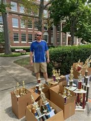 Chess Coaches Todd Andrews and Tiffany Andrews cleared out the team's trophy cases to make room for new awards.