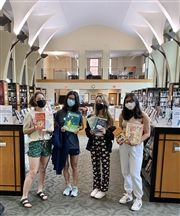 Community Service Club members Kara Grace Hess '23, Sheerea Yu '23, Greta Matthies '22, and Erica Friedman'21 display some of the books ideal for donation.