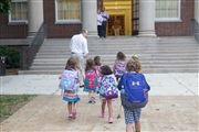 The first item on Director Vince Durnan's agenda each weekday is to walk kindergarteners to class.