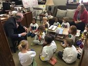 Kindergarteners visit Director Vince Durnan's office on the 100th day of school.