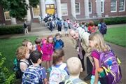Director Vince Durnan talks with kindergartners on the Edgehill lawn before walking them to class.