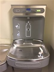 The new hydration station sits above two traditional water fountains.