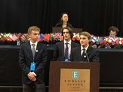 The Netherlands (L-R Shai Rice, Campbell Luschen, Jack Watke) present their award-winning resolution to the General Assembly.