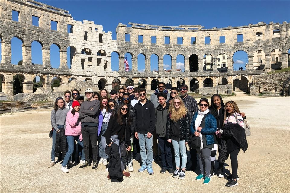 Kelly Neely tours the Roman ruins of Pula with students on their 2019 Winterim trip to Croatia.