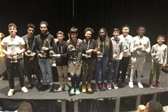 Middle School and JV Award recipients pose with their trophies.