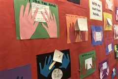 Third graders created artwork using their 'own two hands' to show how they can help others.