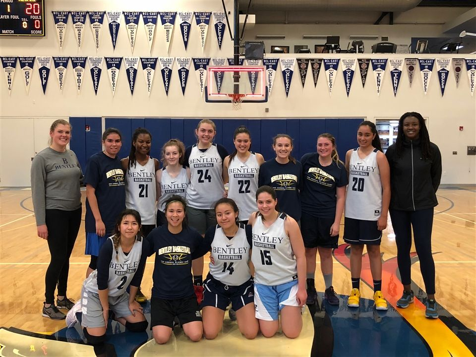 Alumni in blue (left to right): Mandy Bliss '16, Tiffany Chin '09, Sarah Dey '16, Derby Gill '16; Varsity players in white (left to right): Miya K. '19, Elise Noor B. '19, Ali L. '20, Lillia H. '21, Grace K. '20, Ryan P. '19, Alexandra W. '21, Isabella C. '21; Coach Thomas and Coach Drake