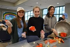 Middle School students prepare and serve a meal four times a year as part of the Life is Delicious community service project.