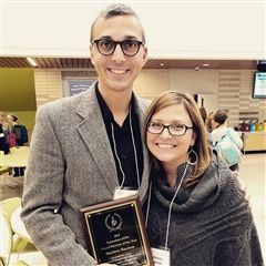 Music teacher Matt Harrison was awarded the Choral Director of the Year by the Connecticut chapter of the American Choral Directors Association. He is pictured at the award ceremony with colleague Amanda Sprague Hanzlik.