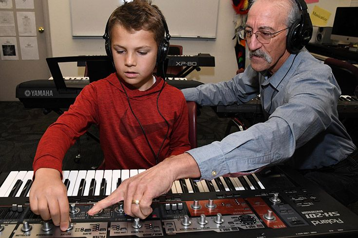 Student and teacher working in the digital music composition studio at Colorado Academy, a top Denver private school.