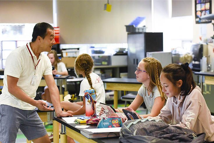 Colorado Academy Middle School Science Teacher Thanh Luong in class