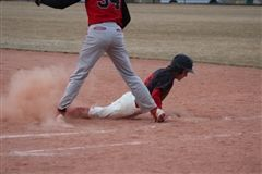 Emmett Ela slides into First Base in the March 13 game against DSST -Stapleton. Photo courtesy Anne Storjohann.