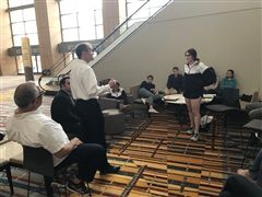 Judge John Madden offering feedback to Erin McCoy as students enter National Mock Trial competition today.