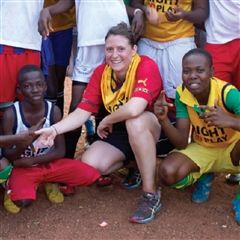 Emma takes a break from working in the Right To Play field office in Ghana to play soccer with a female soccer team.