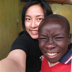 Cynthia with Evans Vilili, part of her host family in 2012, for his first selfie!